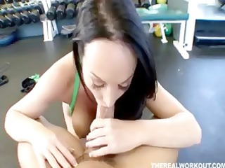 wonderful woman riding her fitness trainer