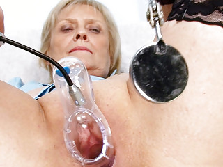 blond elderly medic self exam with vagina spreader