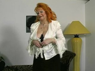 redheaded german elderly demonstrates off for the
