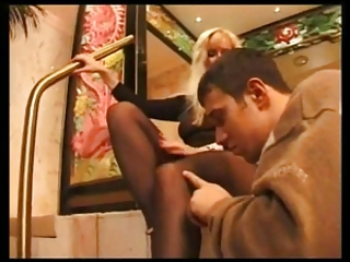 super lady gives a footjob with brown stockings