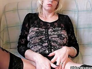 busty grandma in stockings fists her bushy bitch