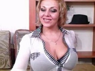 squeezing cougar woman with huge chest