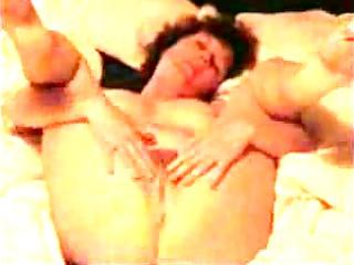 older housewife masturbates on the bedstead