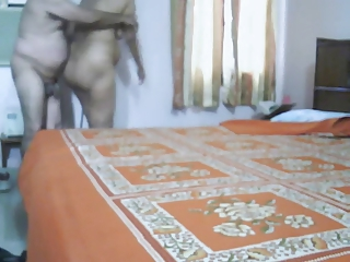 older  indian pair making adore inside bedroom