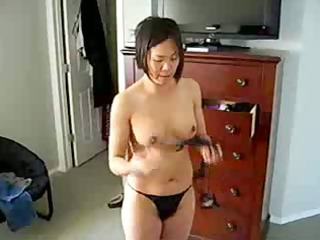 busty chinese lady demonstrates titght figure