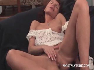 skinny cougar fisting her vagina