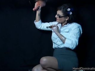smoking gloryhole handjob by dominant mature babe