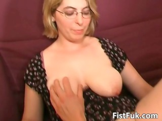 blonde mature babe demonstrates her giant tits