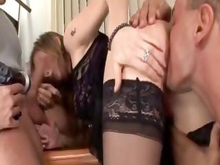 wonderful brunette milf gives a dual dick sucking