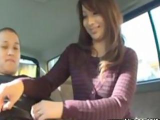 japanese woman gives handjob on backseat of car